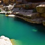 Bassin d'eau dans le wadi Shab, Oman