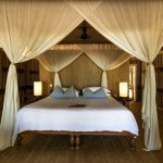 Chambre d'une villa andBeyond sur Mnemba Island