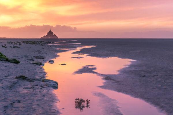 Coucher de soleil sur le Mont Saint-Michel et sa baie